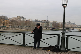 Seine River with a violinist