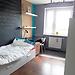 large-sunny-room-big-desk-wardrobe-b10537fa24d6d097bc08c19c5d5131b0