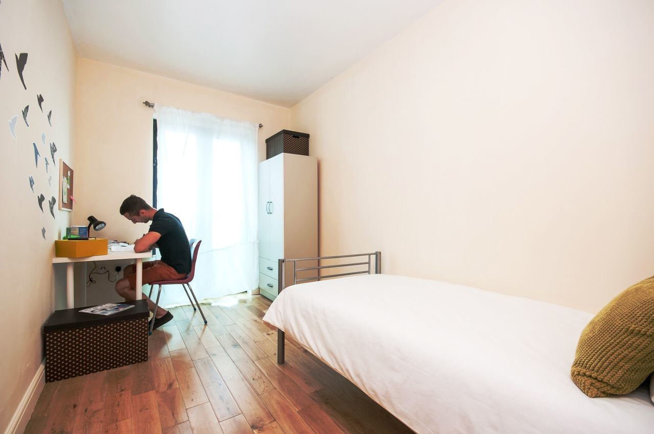 A bed with in single-room available perfect for a student .