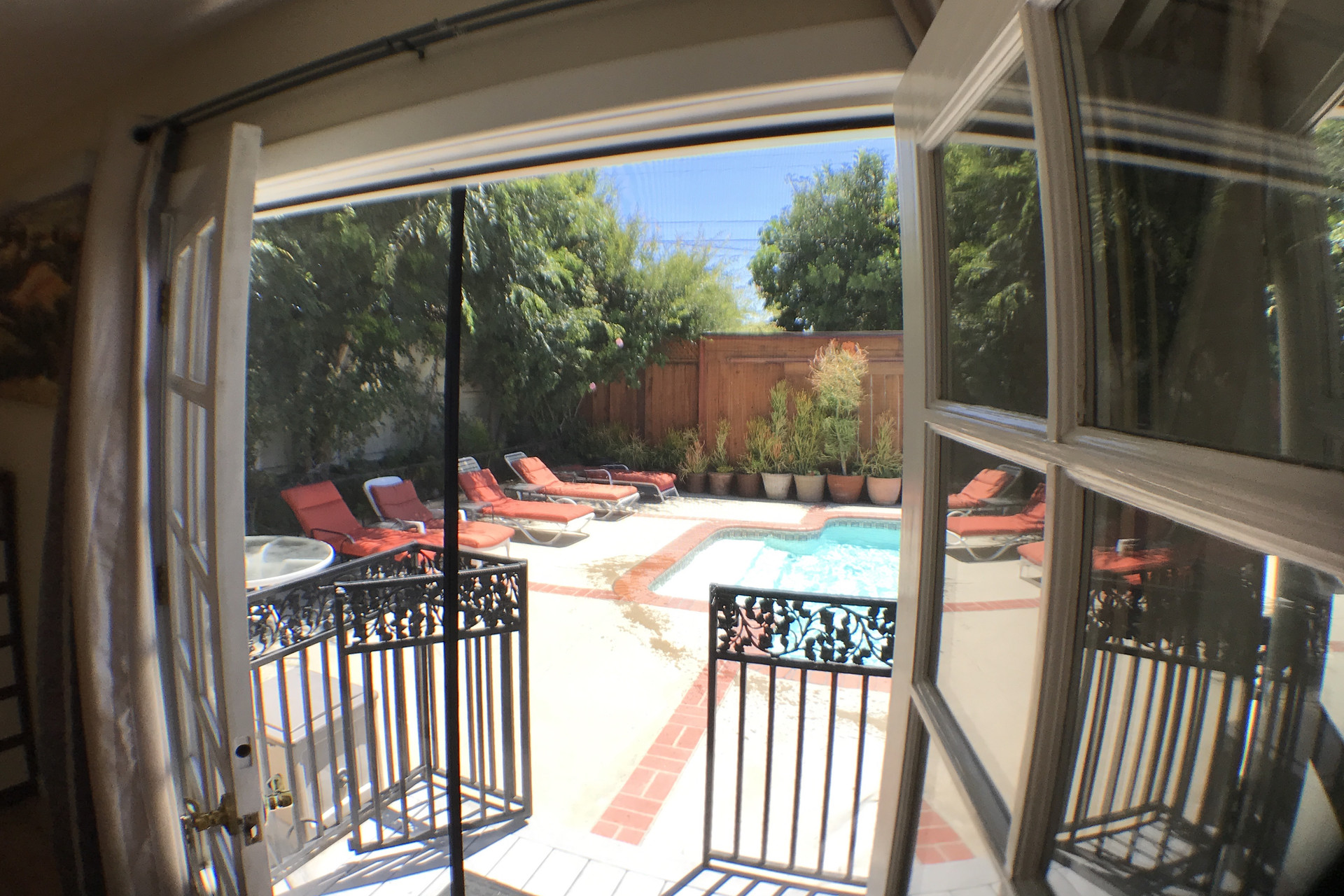 Master Bedroom, french doors open to a beautiful pool and ...