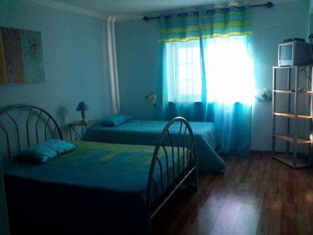 Alugo quarto com duas camas em Sesimbra