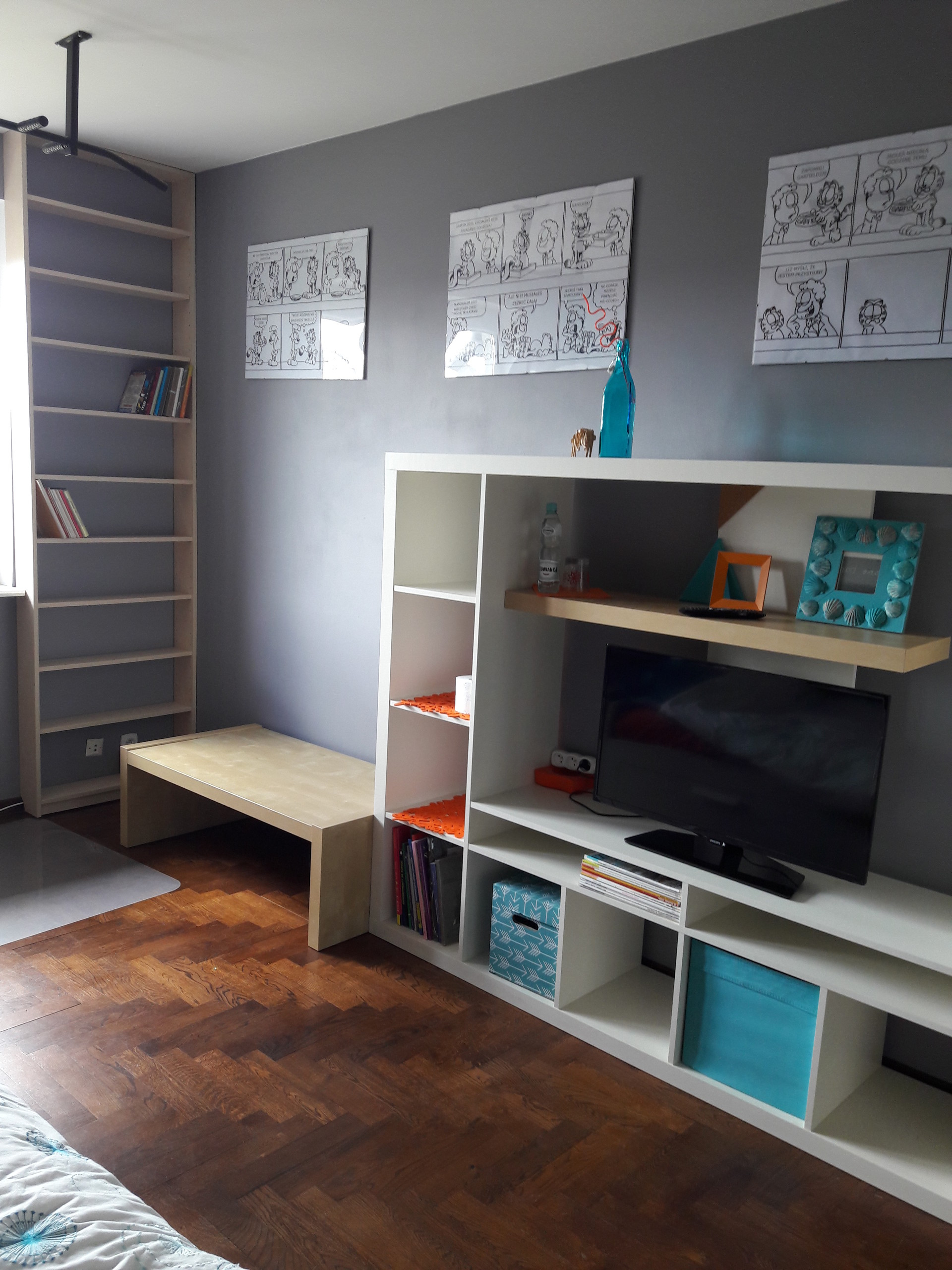 Large sunny  room with a big  desk and wardrobe