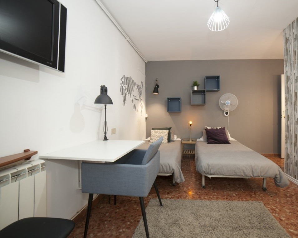 Spacious room with double bed and balcony in a student residence