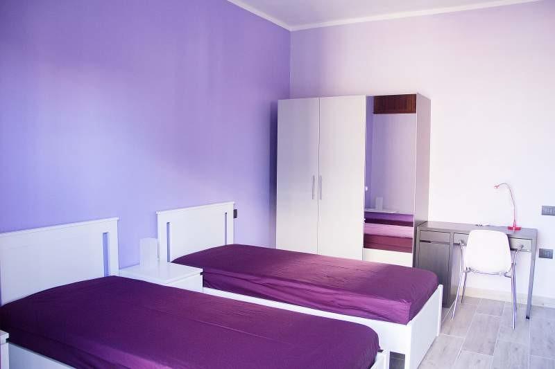 stanza con due letti singoli uso doppia o singola
