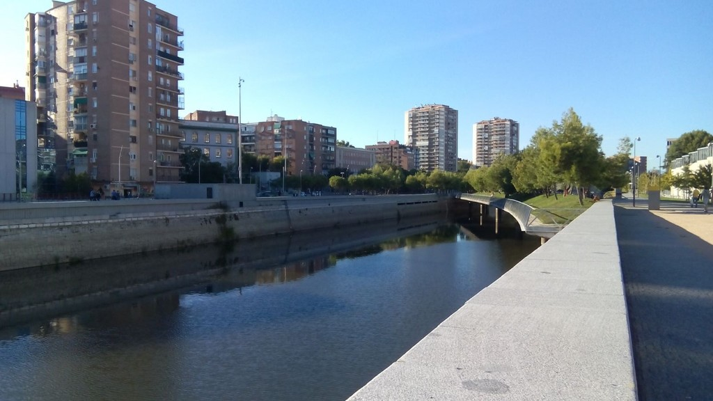 Walk alongside the Manzanares River and enjoy a Beautiful View of the Royal Palace and the Almudena Cathedral